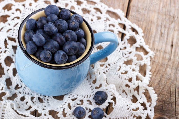 Ripe blueberries in a cup