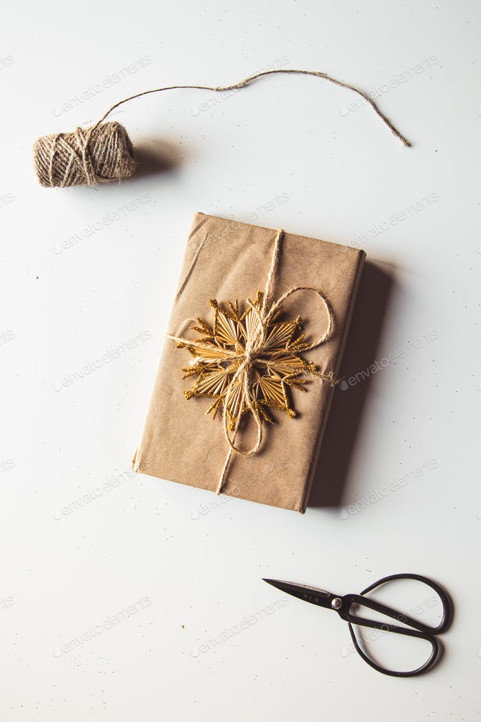 Kraft paper gift box Christmas rope isolated on white background. Top view