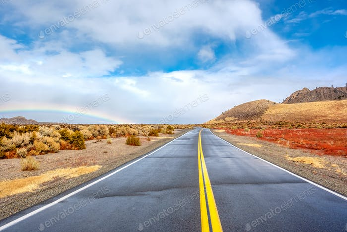 Open highway and rainbow