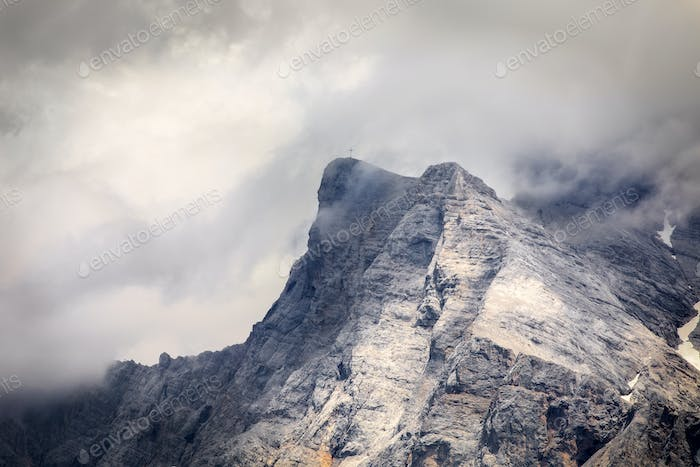 mountain rocky peak in clouds