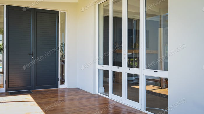 Empty porch with doors at modern home on a sunny day