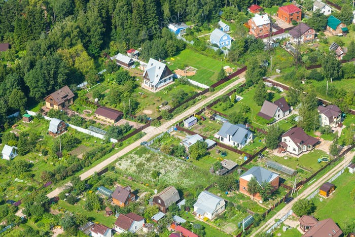above view of cottages in suburb village in summer