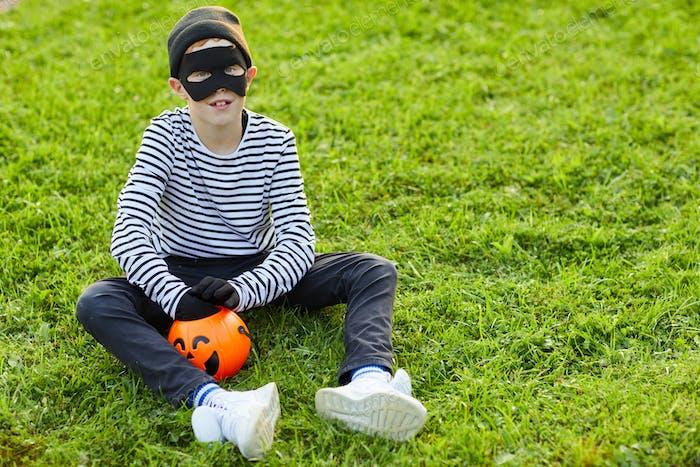 Little Boy Wearing Halloween Costume Outdoors
