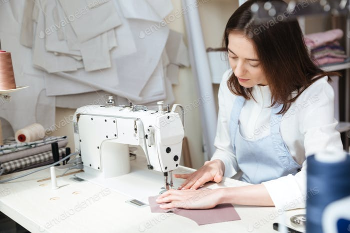 Image of seamstress working with sewing machine