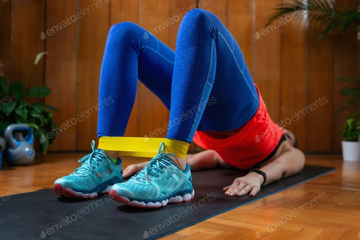 Woman Exercising With Elastic Band