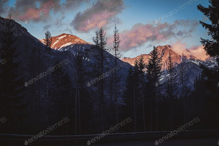 Mountains at sunset time with pink clouds