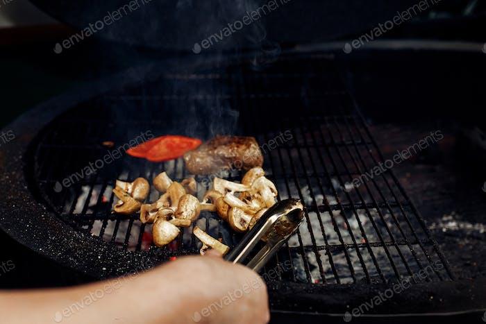 Beefsteak mushrooms  tomatos garlic on grill