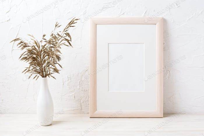 Wooden frame mockup with dried grass