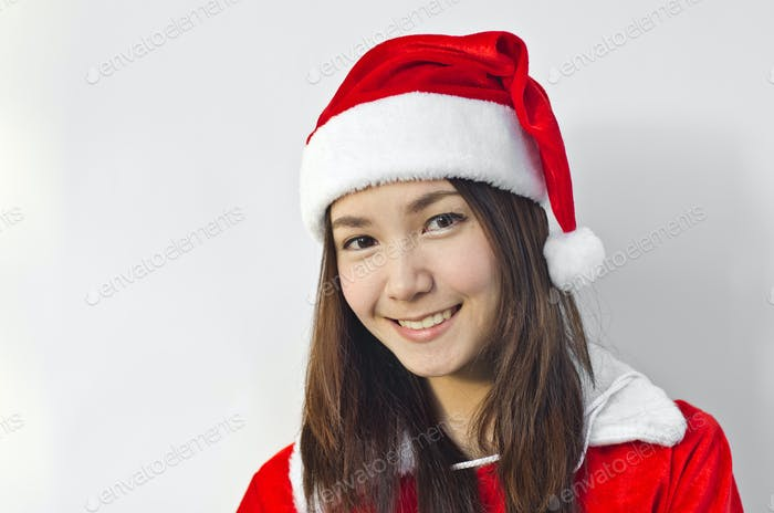 Beautiful young santa clause woman, isolated