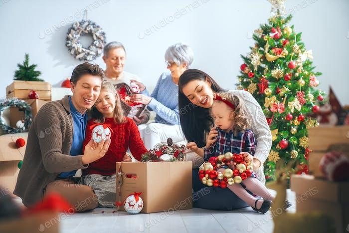 family preparing for Christmas