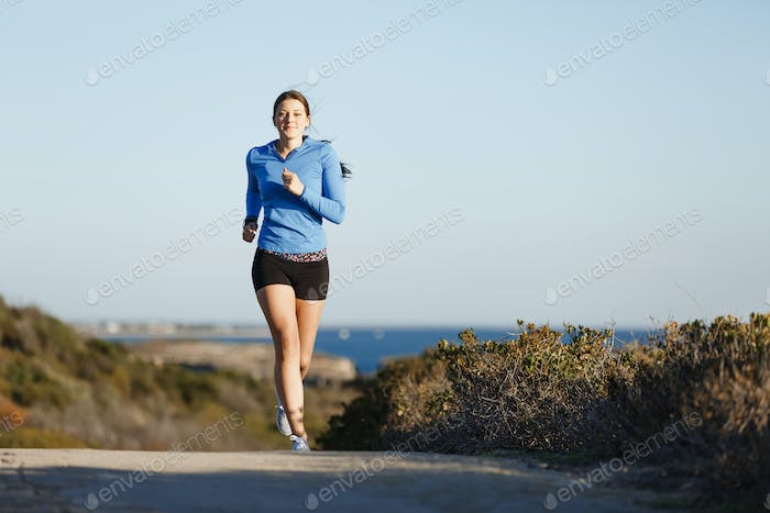 Sport runner jogging on beach working out
