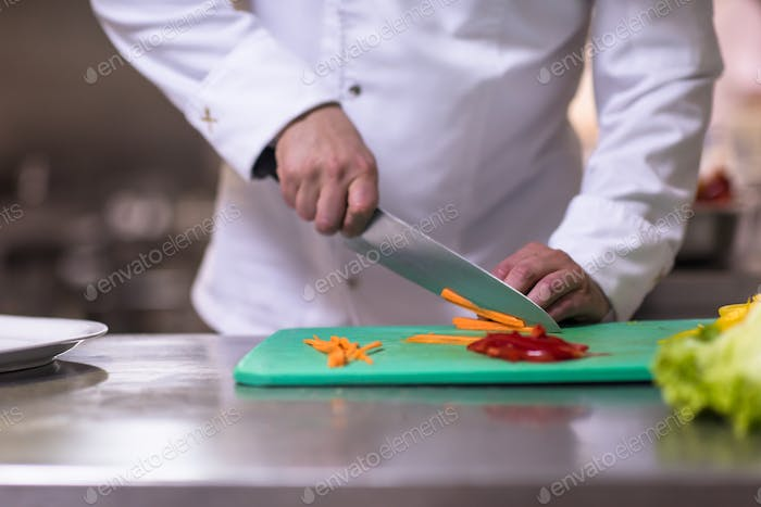 Chef hands cutting fresh and delicious vegetables