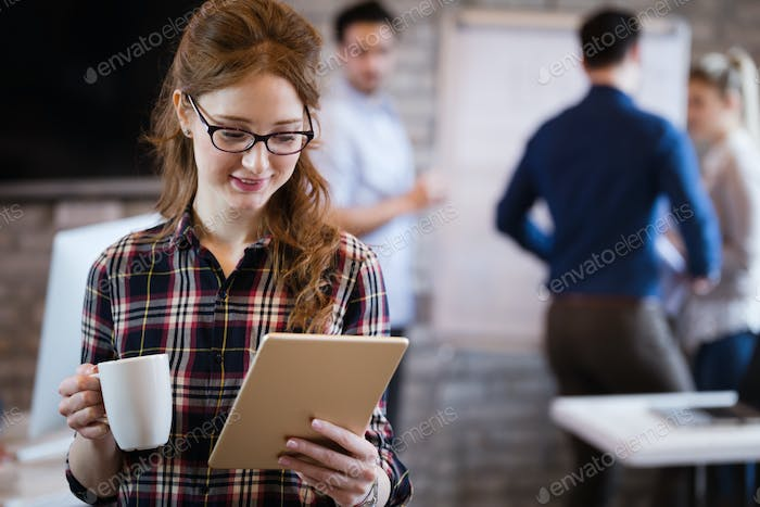 Young attractive architect working in modern office