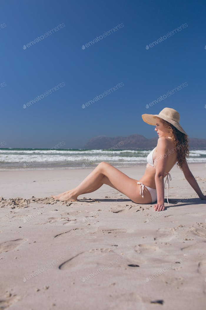 Woman relaxing siitng at beach