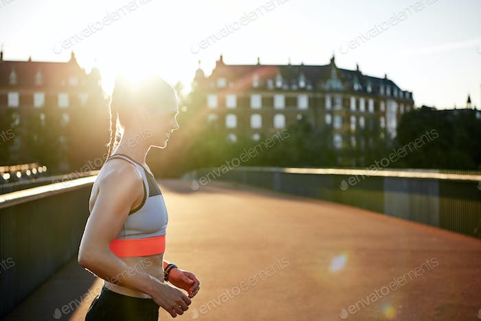 Woman in athletic wear exercising outdoors