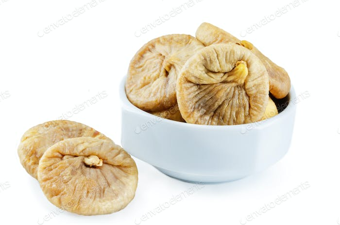 Dried Figs fruits in a bowl isolated