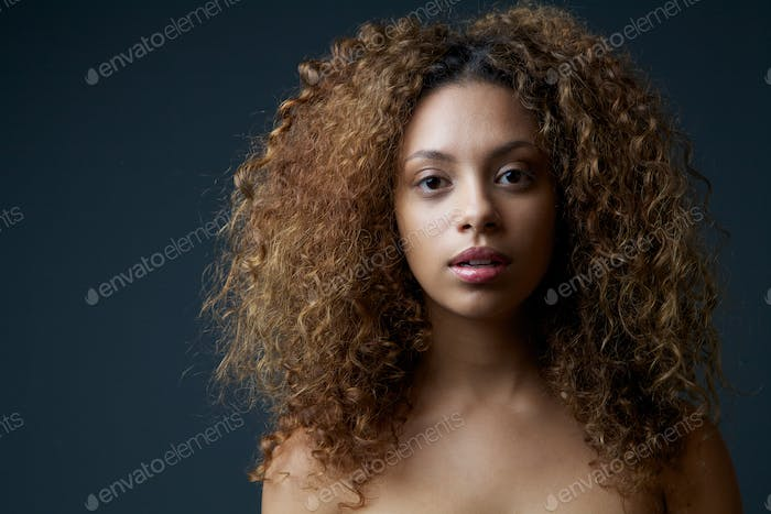 Beautiful female fashion model with curly hair