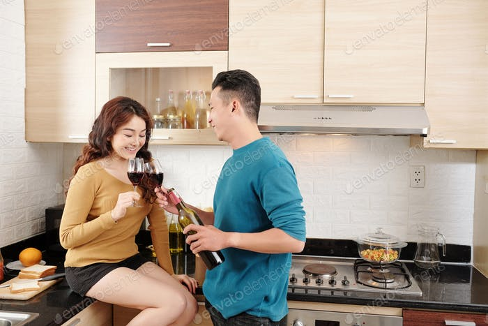 COuple drinking at kitchen counter