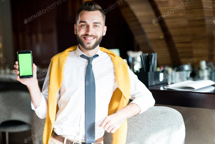 Handsome Businessman Presenting App
