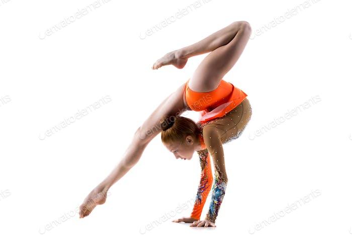 Teenage dancer girl doing handstand