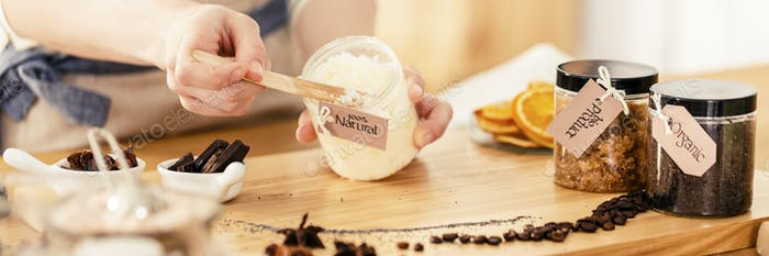 Person mixing natural coconut mass