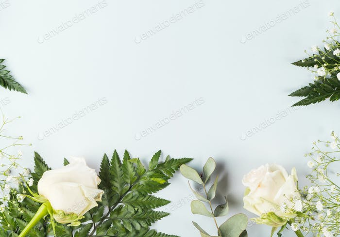 Floral arrangement frame with white roses and fern