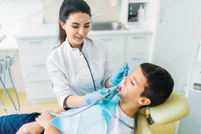 Caries removal procedure, children stomatology