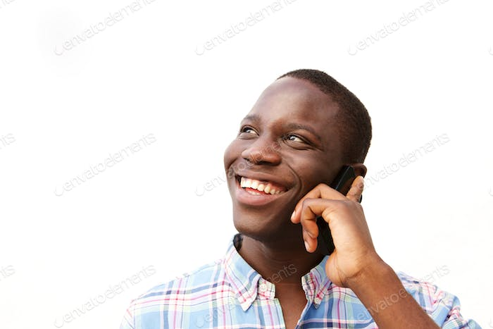 happy black guy talking on mobile phone against white background