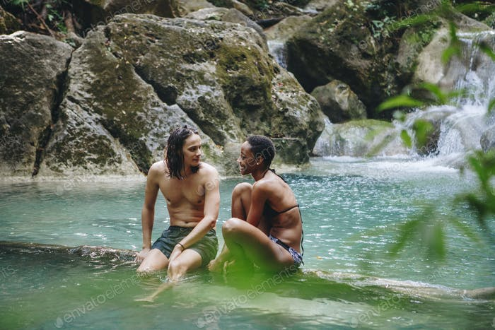 Couple enjoying the waterfall