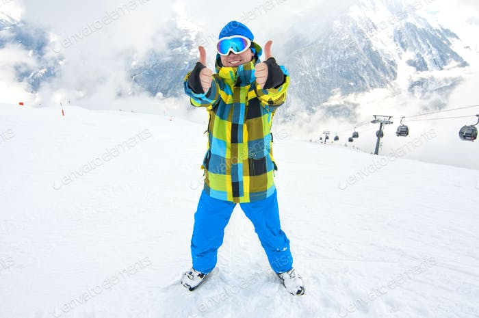 man showing thumbs up on slope