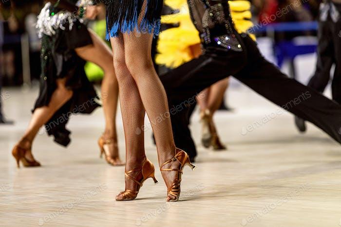 legs female dancer in fishnet stockings
