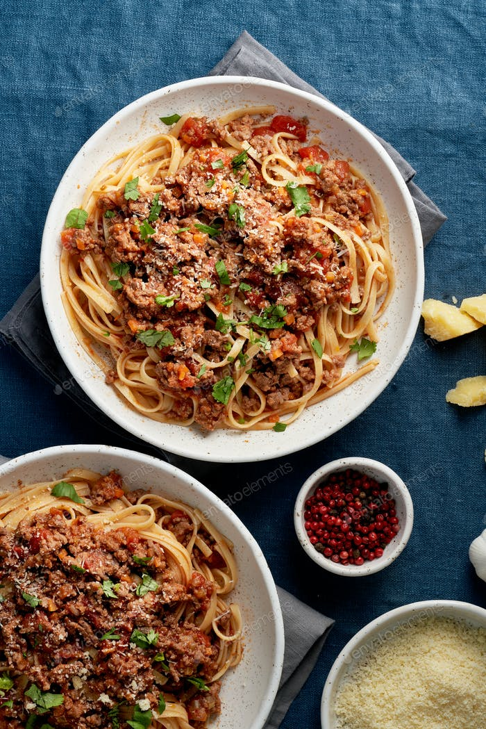 Pasta Bolognese Linguine with mincemeat, tomatoes, parmesan cheese. Italian dinner for two person