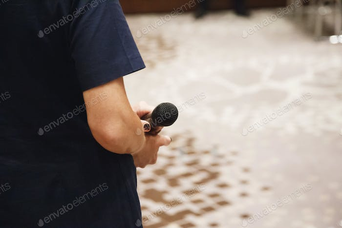 Microphone in speaker's hands at conference