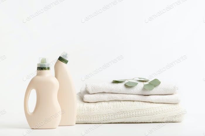 Washing Detergent with softener and white towel