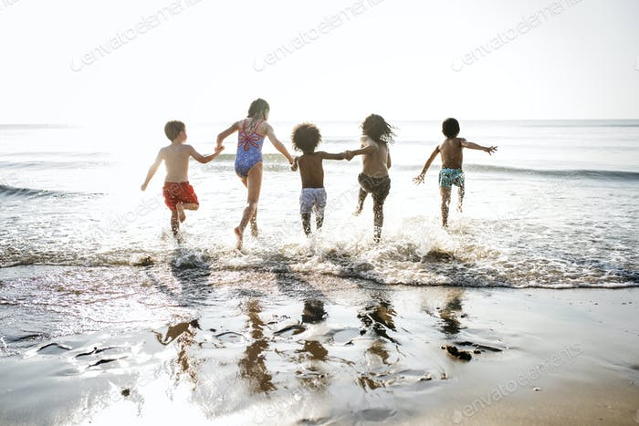 Kids running at the beach