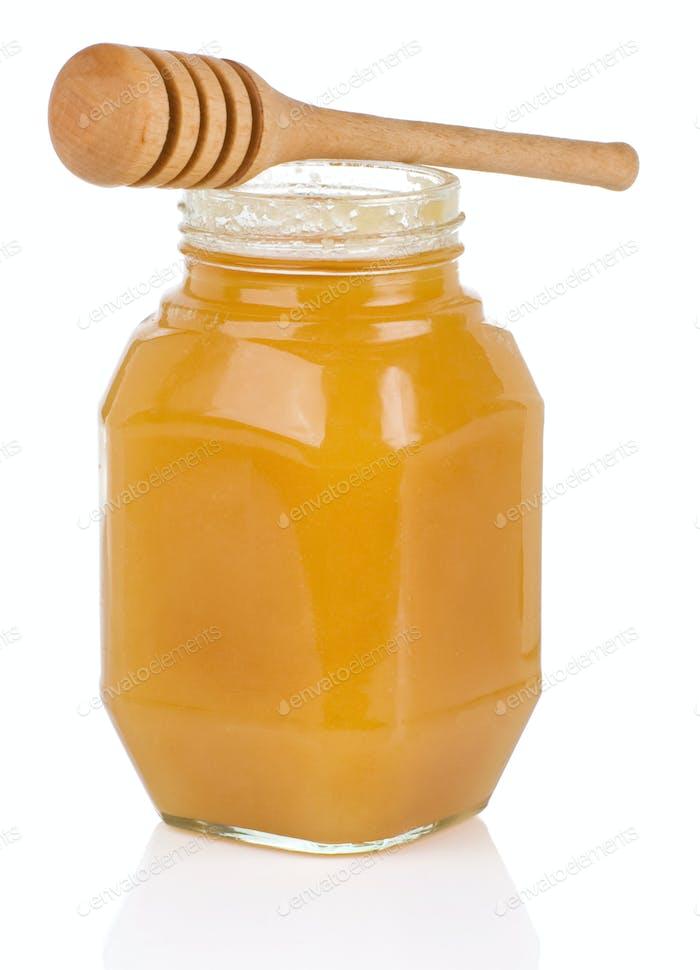 jars full of honey isolated on white