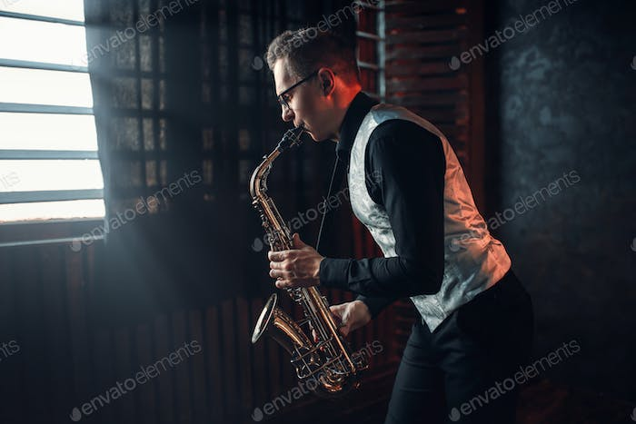 Saxophonist playing jazz melody on saxophone
