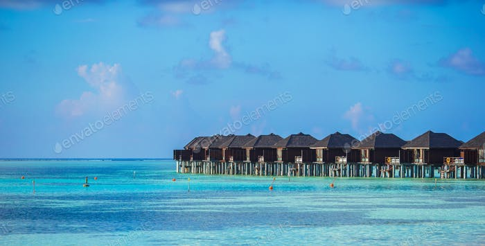 Water bungalows on ideal perfect tropical island