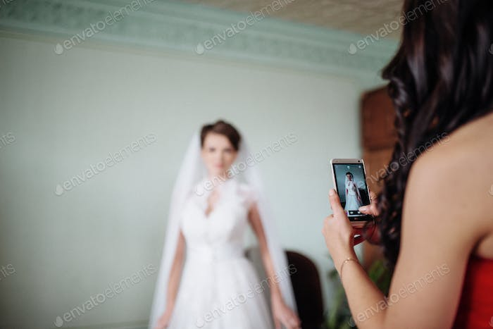 Image of a woman who takes  photo