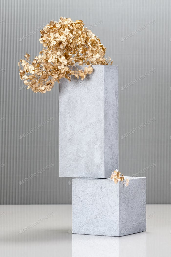 Installation using concrete blocks and a golden plant.