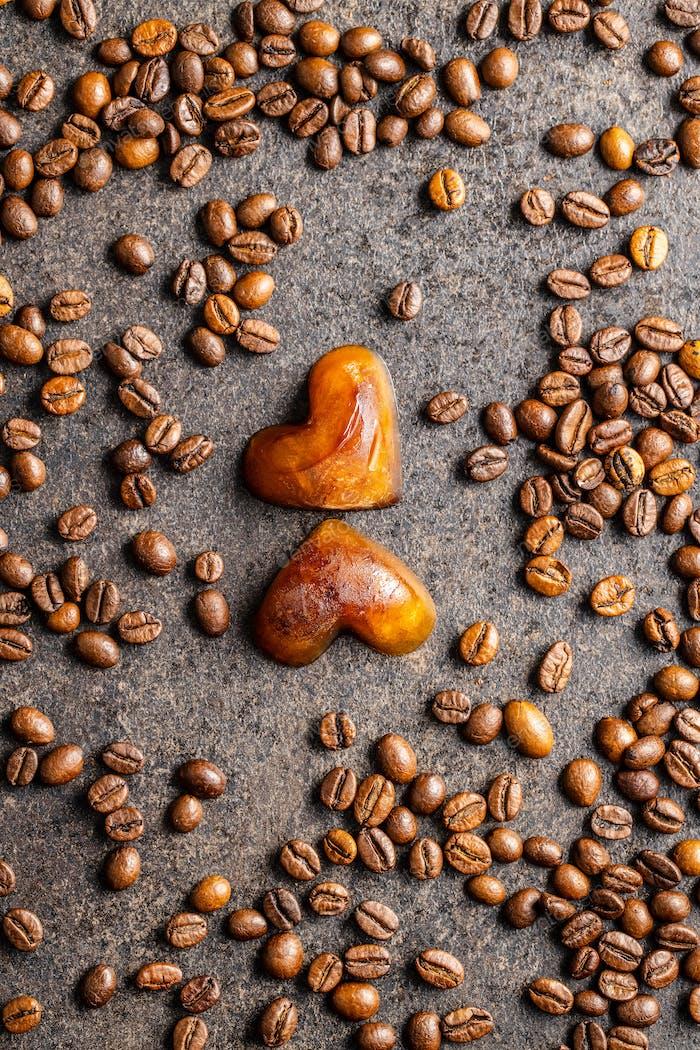 Frozen coffee shaped like heart. Coffee ice cubes.