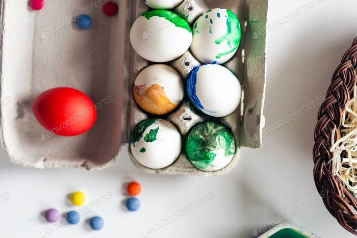 Easter background. Top view.  Colorful eggs lie on the table.- Image