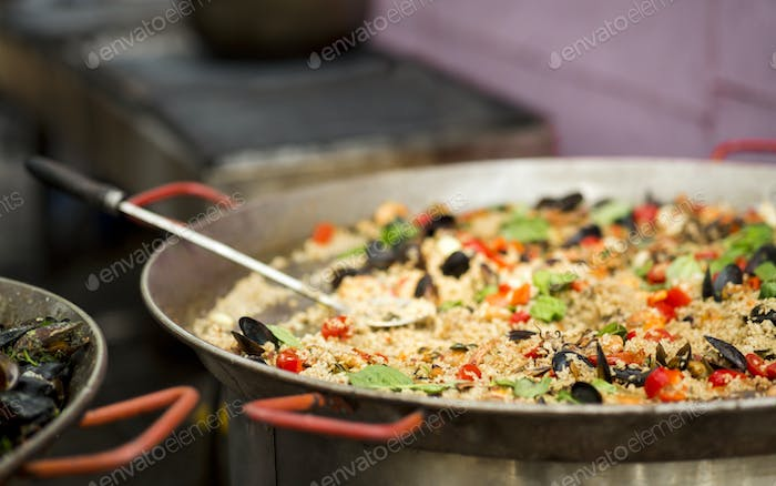 Tasty and juicy pilaf with mediterranean mussels in bowl outdoor