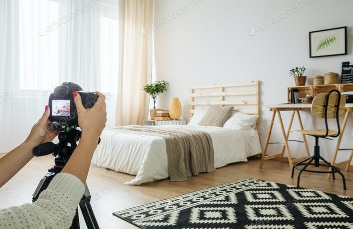 Blogger taking a photo of bedroom