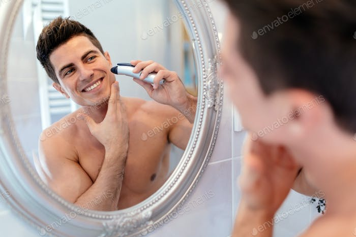 Happy handsome man shaving