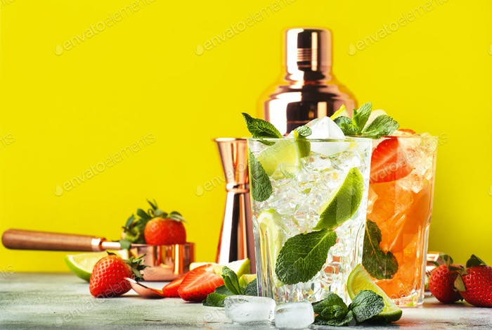 Mojito cocktail set with lime, mint, strawberry and ice in glass on yellow background