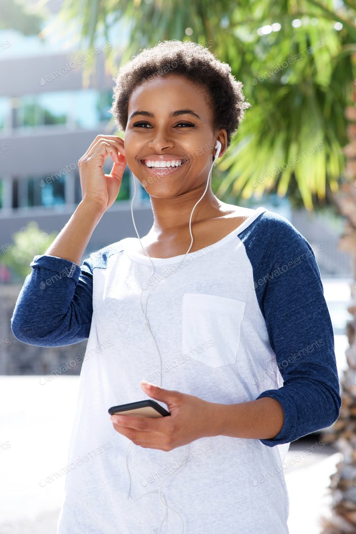 young woman listening rot music with earphones