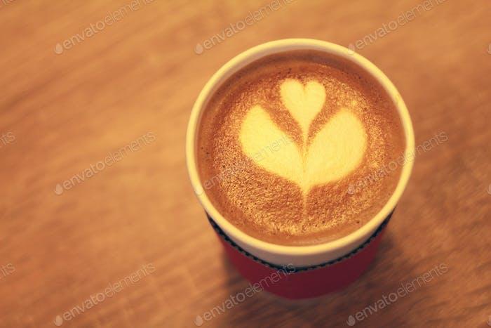 Latte in a takeaway cup
