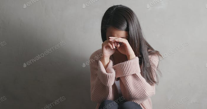 Depression woman crying over gray background