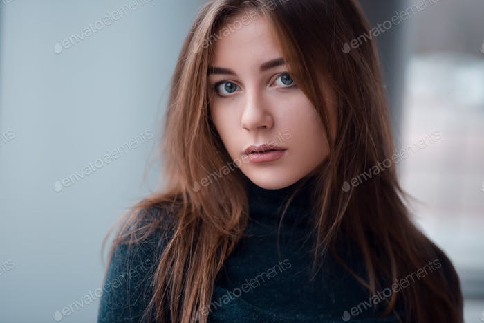 Portrait close up of glamour woman with long hair.